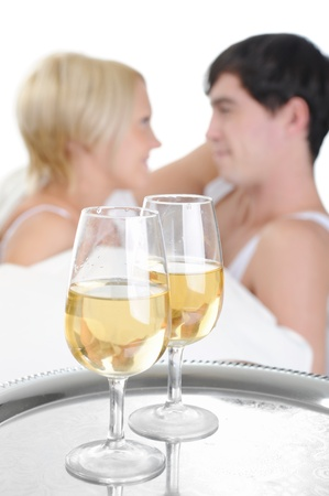 Young couple drinking champagne in bed photo