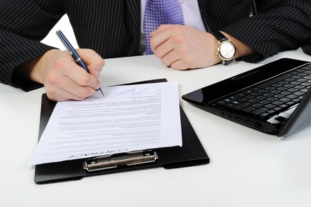 Businessman signs a contract