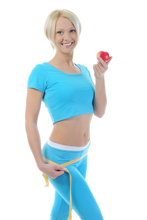 Young athletic women measuring waist. photo