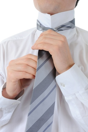 Businessman tying his tie photo
