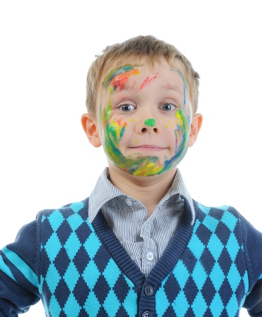 boy with paint stained face photo