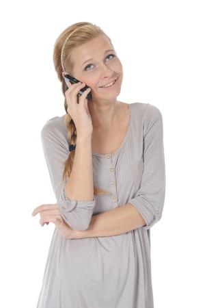 schöne Frau mit einem Telefon in seiner Hand. Lizenzfreie Bilder - 8734663