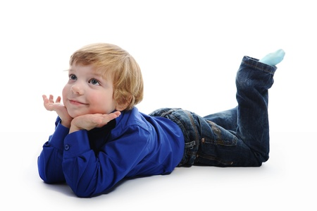 lying on the floor: Little boy Stock Photo
