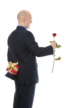 birthday suit: man with a gift box and a rose Stock Photo