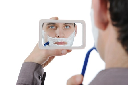 Young man shaving Stock Photo - 8734996