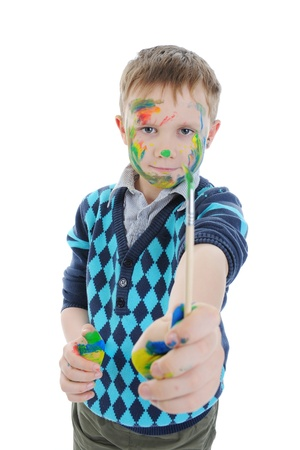 smiling boy with the paintbrush. Stock Photo - 8734992
