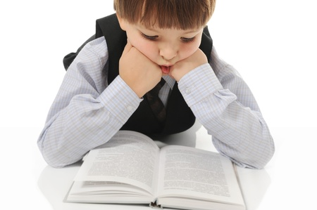Boy reading a book Stock Photo - 8735272