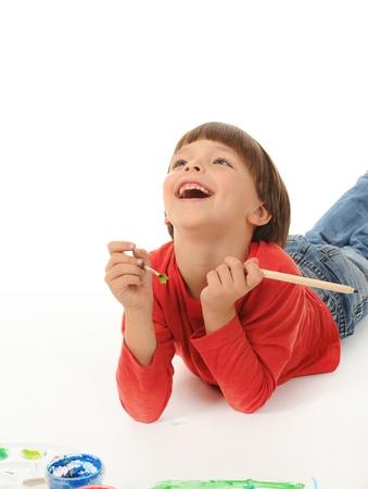 little boy paints photo