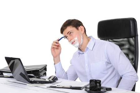 shaving blade: Businessman shaves in the workplace