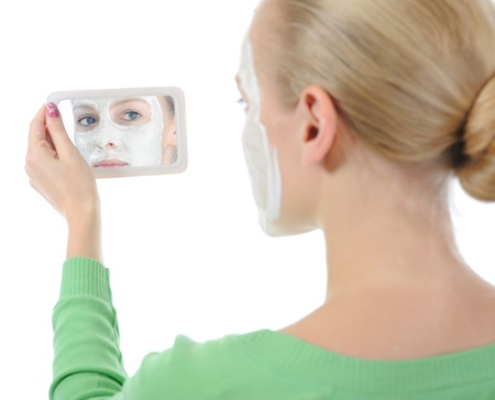 young woman making a mask Stock Photo - 8734984