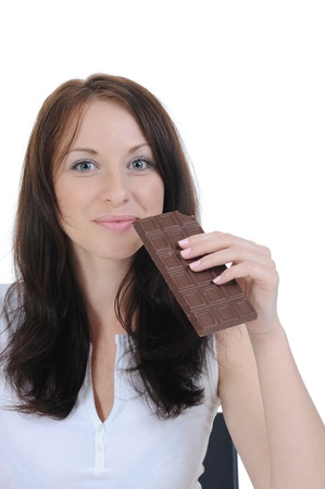girl eating chocolate. photo