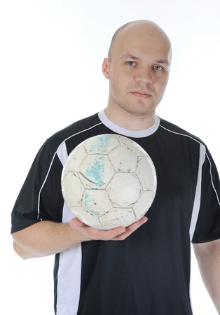 Football player with the ball in his hands. photo