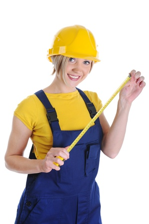 Girl the builder in a yellow helmet photo