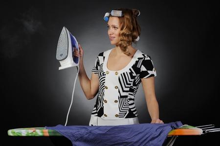 woman stroking men shirt. photo