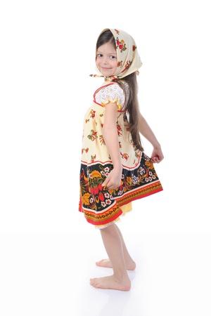 girl in a dress dances. photo