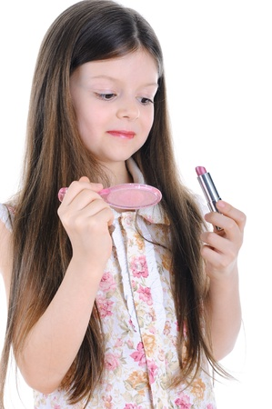 Little girl paints lips Stock Photo - 8880707