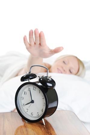 Sleepy woman turns off the alarm Stock Photo - 8880759