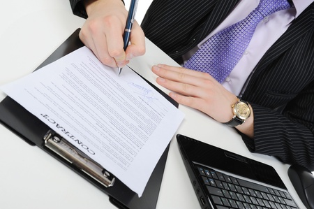 subscribing: Businessman signs a contract