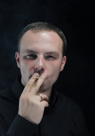 young man smoking a cigarette photo