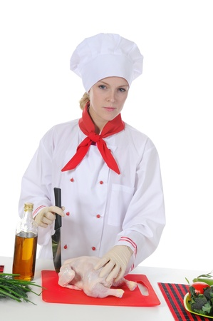 Handsome young chef in uniform. photo