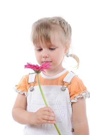 girl sniffs a flower. photo