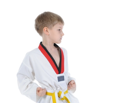 Boy in a martial art uniform photo