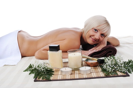 Young blonde woman at spa procedure photo