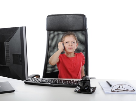 Little girl in the office computer. photo
