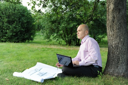 man with laptop sitting near a tree Stock Photo - 8889276