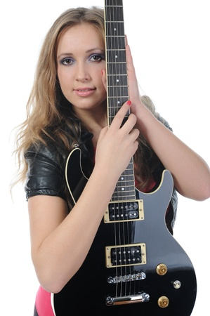 woman in a full-length with a black guitar photo