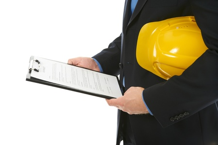 Businessman with construction helmet photo