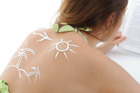 woman with sun-shaped sun cream photo