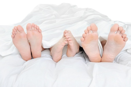 feet in bed: Close-up of the feet
