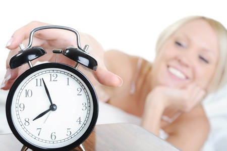 Sleepy woman turns off the alarm Stock Photo - 8889673