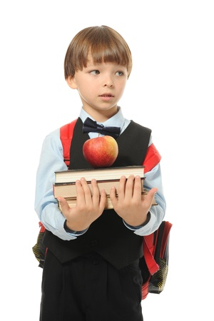 boy holds a stack of books photo