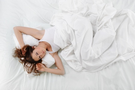 white blanket: woman sleeping on the bed