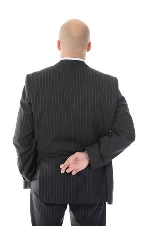 etica:  hombre de negocios con los dedos cruzados en la espalda  Foto de archivo