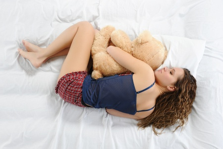 innocent: Young woman with teddybear