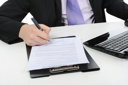 Businessman signs a contract Stock Photo - 8891782