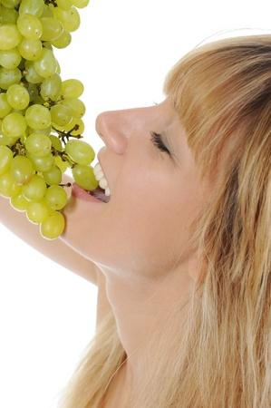 Girl eating grapes photo