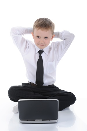 boy with a laptop sitting on the floor. Stock Photo - 8891860