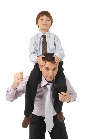 lucky son sitting on his father stretches Stock Photo - 8891864