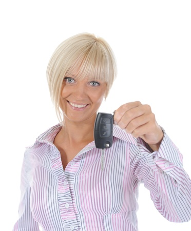 woman holds the key to the car photo