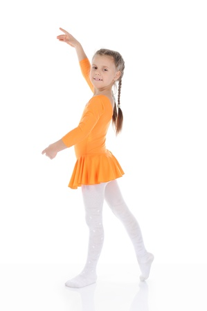 beautiful ballerina dancing in an orange dress. photo