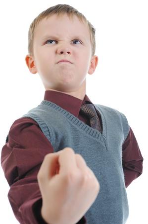 bambini pensierosi: Little bullo minaccia pugno Archivio Fotografico