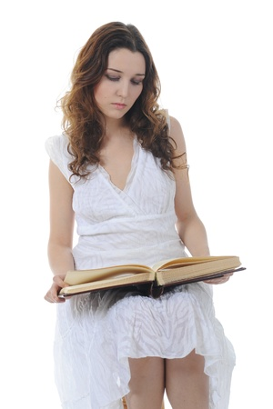 young girl reading book photo