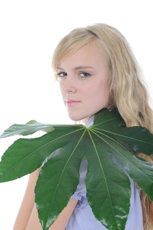 woman with green leaf photo