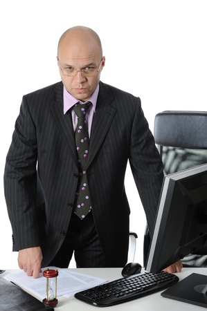 businessman standing at the table in his office. photo