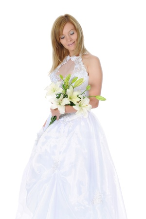 Happy bride with a bouquet of lilies photo