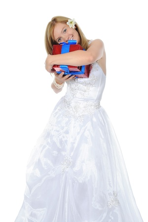 Bride hugging gift box. photo